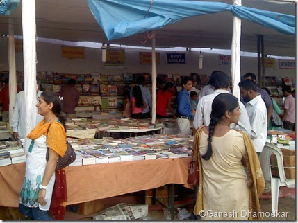 People enjoying going through books at National Book Fair Nagpur.  This fair has become an integral part of reading culture in Nagpur over the years.